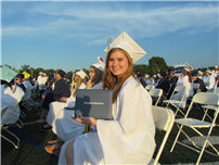 Graduate Smiles With Diploma thumbnail121372