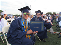 Graduate Smiles After Receiving Diploma thumbnail121371